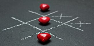 Red Heart Shaped Beads Tic Tac Toe Buttons Stock Photos