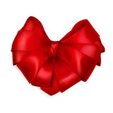 Red heart-shaped bow. Red bow heart shaped made of shiny ribbon Royalty Free Stock Photos