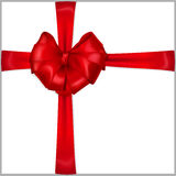 Red heart-shaped bow with ribbons. Red bow heart shaped with crosswise ribbons Stock Photos