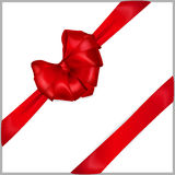 Red heart-shaped bow with ribbons. Red bow heart shaped with diagonally ribbons Royalty Free Stock Images