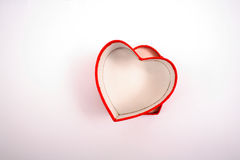 Red  heart-shaped box Stock Photos
