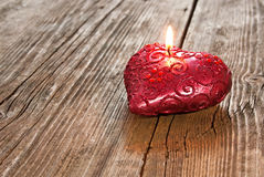 Red heart shaped candle Royalty Free Stock Images