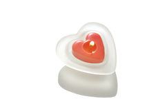Red heart-shaped candle burning.  Royalty Free Stock Photo
