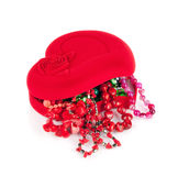Red heart-shaped casket and beads Stock Photography