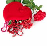 Red heart-shaped casket with beads of  semi-precious stones and Royalty Free Stock Images