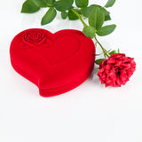 Red heart-shaped casket and rose. Valentine card Royalty Free Stock Images