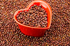 Red heart-shaped dish and red beans Royalty Free Stock Photo