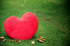 Red heart shaped on grass Stock Photography