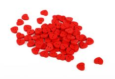 Red heart shaped sewing buttons isolated on white Royalty Free Stock Photography