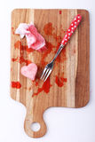 Red heart-shaped ice from raspberry syrup with silver fork Royalty Free Stock Photos