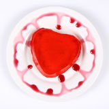 Red heart shaped jello. Decorated with custard Stock Image