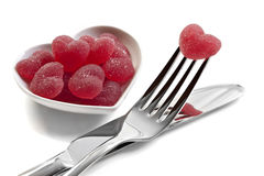 Red heart shaped jelly sweets with cutlery Royalty Free Stock Photos