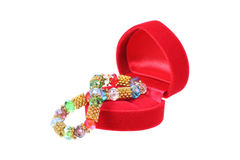 red heart shaped jewelry box with jewelry isolated on white Stock Photos