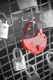 Red heart-shaped lock on a bridge. Royalty Free Stock Photos