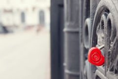 Red heart shaped lock on grey bridge. Love concept. Red heart shaped lock on grey bridge. Romance love concept Stock Photos
