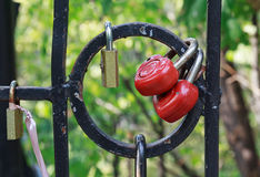 Red heart-shaped locks are hanging Royalty Free Stock Photos