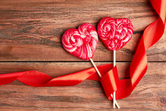 Red heart-shaped lollipops. Royalty Free Stock Image