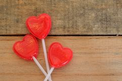 Red heart shaped lollipops in floral shape Stock Photography