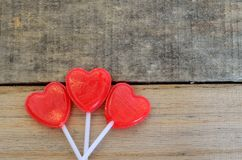 Red heart shaped lollipops in floral shape Royalty Free Stock Image