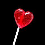 Red heart-shaped lollypop. Shot over black background Stock Photography