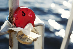 Red heart shaped love locks on the fence of the bridge Royalty Free Stock Photos