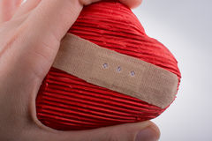 Red heart shaped object in hand Royalty Free Stock Photo