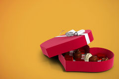 Red heart shaped open candy box Stock Image