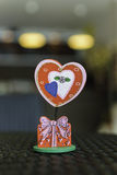 The red heart-shaped paper clip. On table in cafe Stock Photography