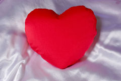 Red heart shaped pillow Royalty Free Stock Images