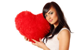 Red heart-shaped pillow Stock Photo