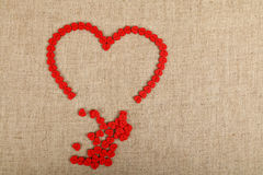 Red heart shaped sewing buttons on canvas Royalty Free Stock Photography