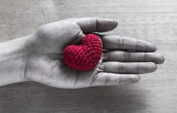 Red Heart Shaped Silk on Hands Royalty Free Stock Photo