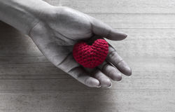 Red Heart Shaped Silk on Hands Stock Photo