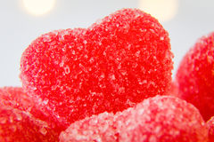 Red heart shaped sugar candy in a bowl. Red heart shaped sugar coated candy closeup for Valentine`s Day stock photography