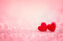 Red Heart shapes on abstract light glitter background in love c Royalty Free Stock Photography