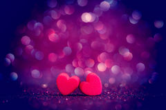 Red Heart shapes on abstract light glitter background in love co Royalty Free Stock Image