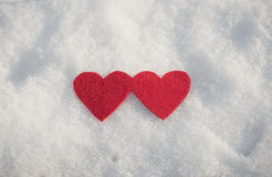 Red heart shapes on snow Royalty Free Stock Image