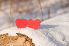 Red heart shapes on snow Stock Photography