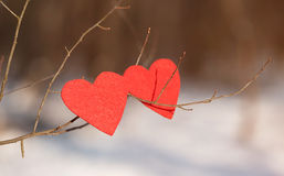 Red heart shapes on snow Royalty Free Stock Photos