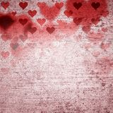 Red hearts on grunge textured background. Red heart shapes on textured grunge background Royalty Free Stock Photo