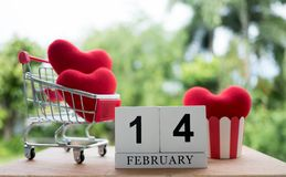 Red heart in a shopping cart on February 14.Valentine day royalty free stock images