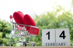 Red heart in a shopping cart on February 14.Valentine day royalty free stock image