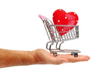 Red heart in a shopping trolley on a white Stock Images