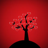 Red heart on silhouette tree. On red background. Valentine postcard concept Stock Images