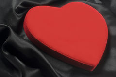 Red heart on silky wavy fabric Royalty Free Stock Image
