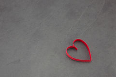 Red heart. Single red heart on a slate background Stock Image