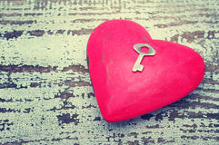 Red heart and small metal key. Royalty Free Stock Photo