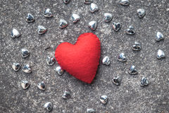 Red heart with small siver heart on cement floor Royalty Free Stock Photography