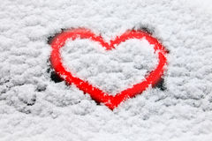 Red heart in snow Royalty Free Stock Photo