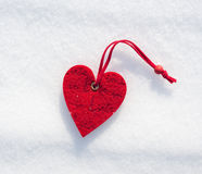 Red heart on snow Royalty Free Stock Images